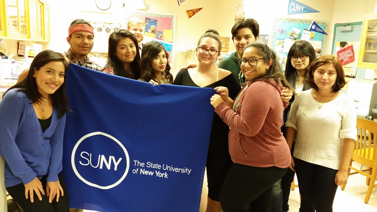 Students holding CUNY banner during college application week