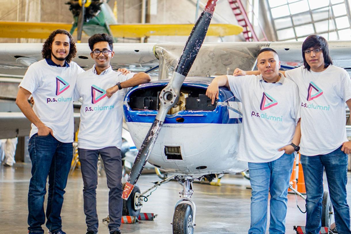 Alumni Day 2018: Alumni at an airplane hanger