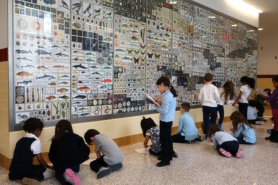 Children studying the artwork Cabinet by Penelope Umbrico