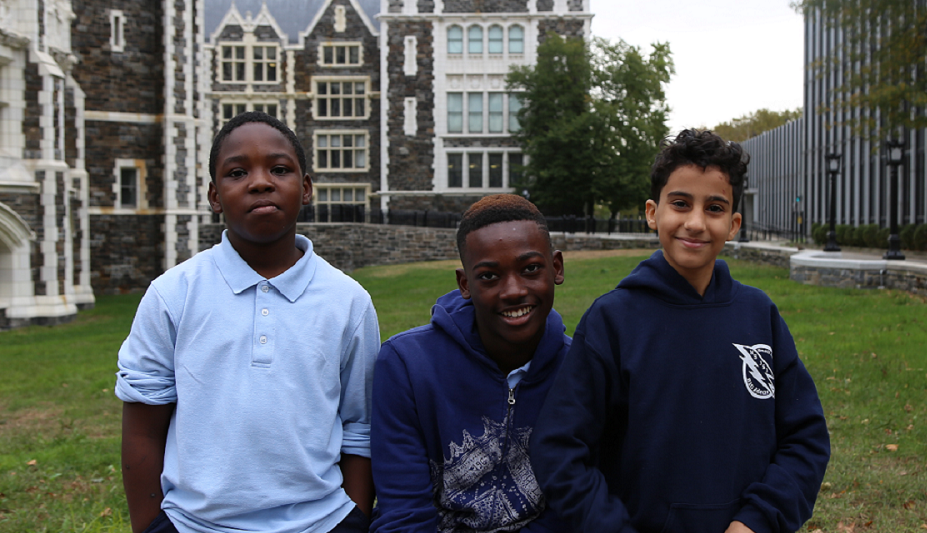 Three students visiting a college campus