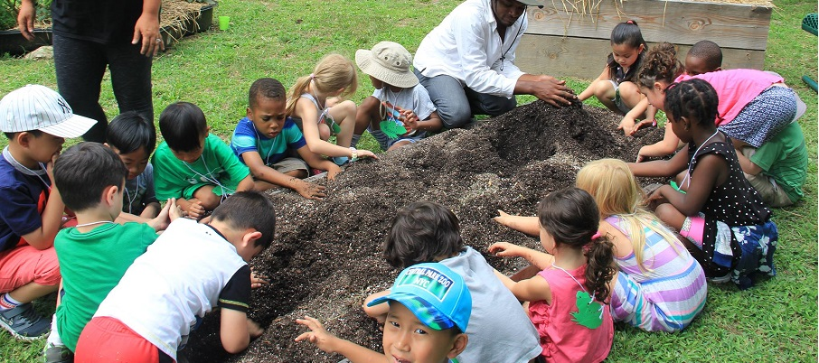 Young children getting into the dirt at the Environmental Study Center