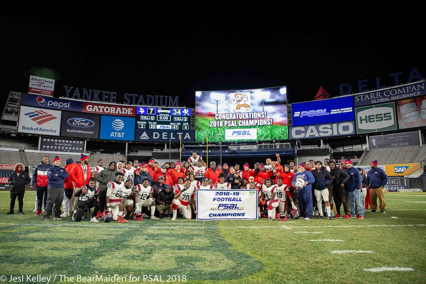 Football Champions at Yankees stadium posing after the big win