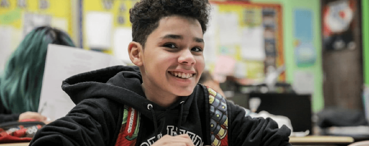 High School student smiling in classroom