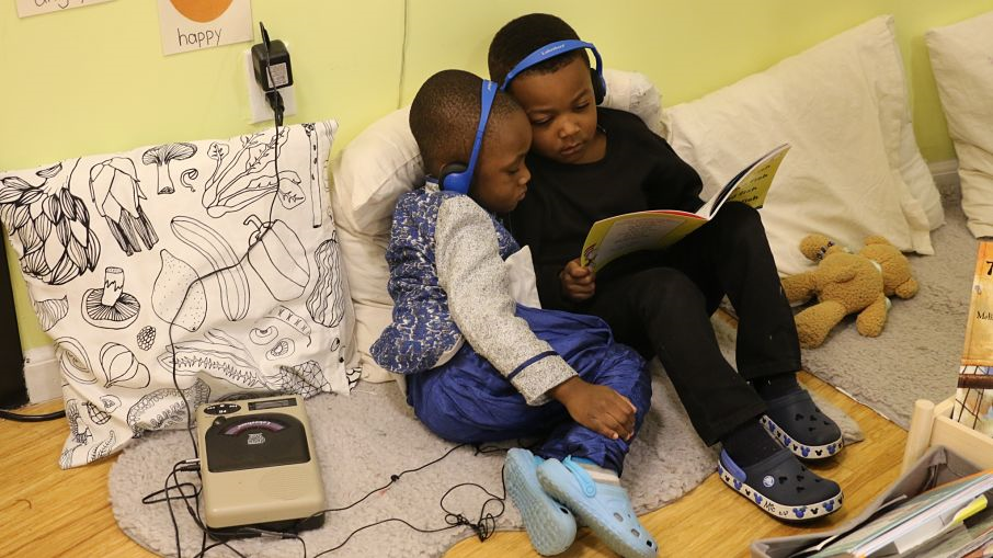 Students listen to an audiobook together.