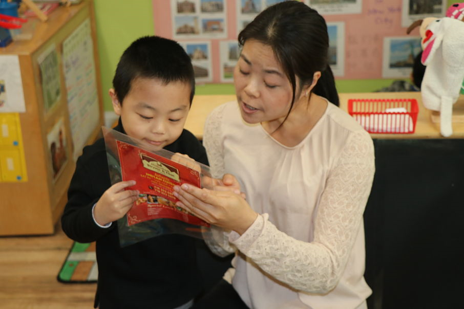 Mother reading with student