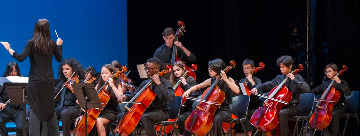 Children's orchestra playing violins