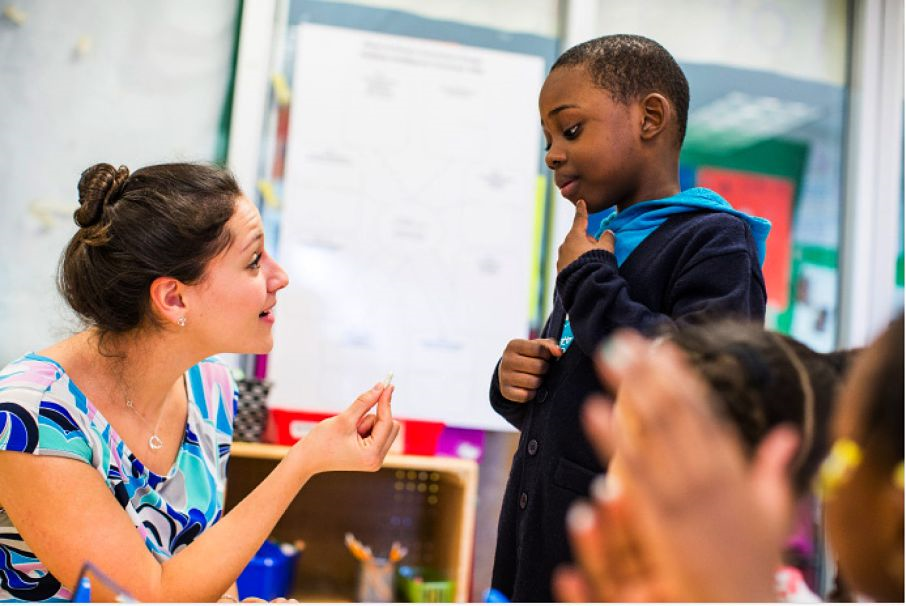 A child asks his teacher a question.