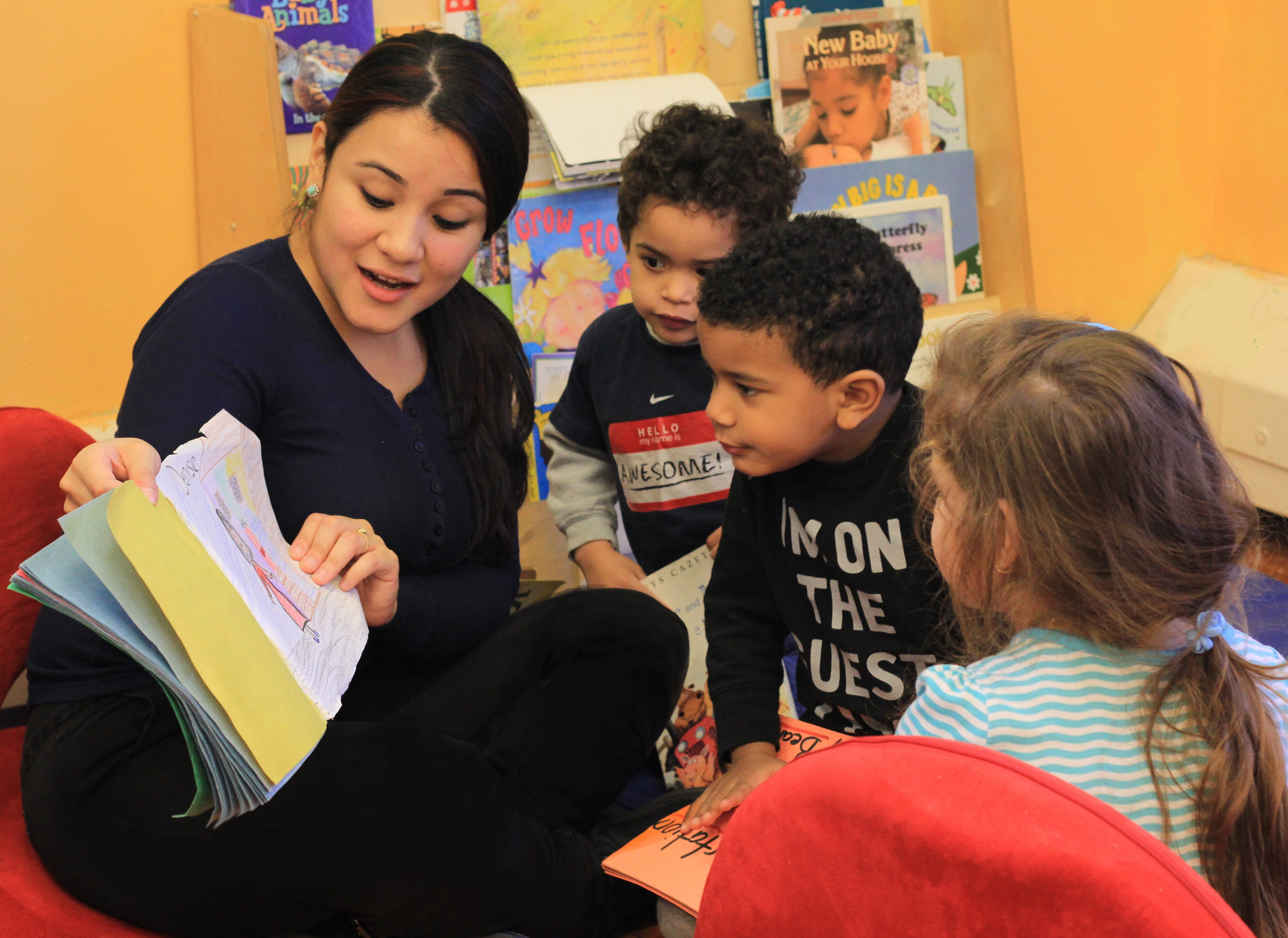 A teacher reads aloud with young children.