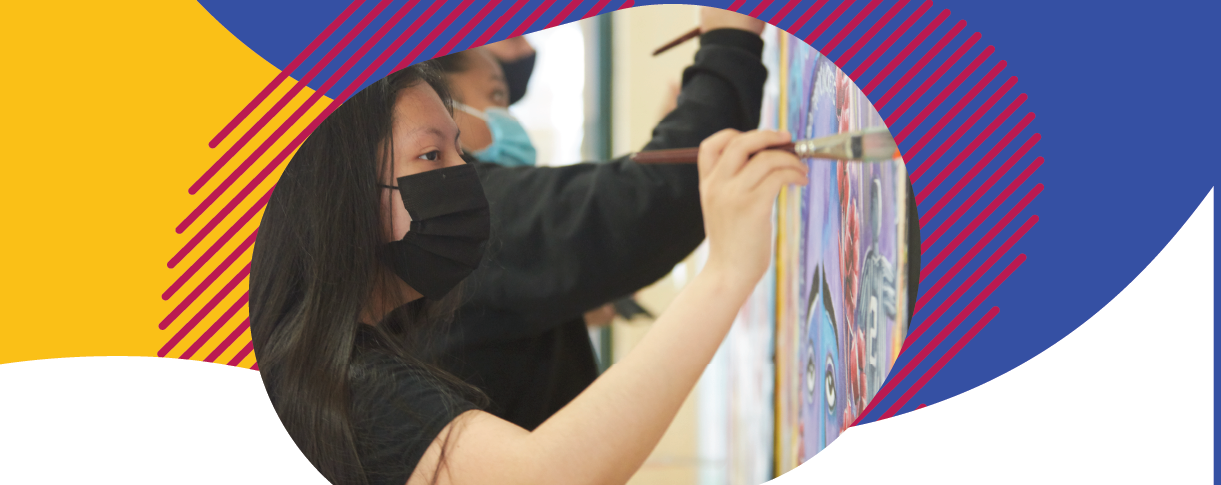 High School students painting with colorful background design