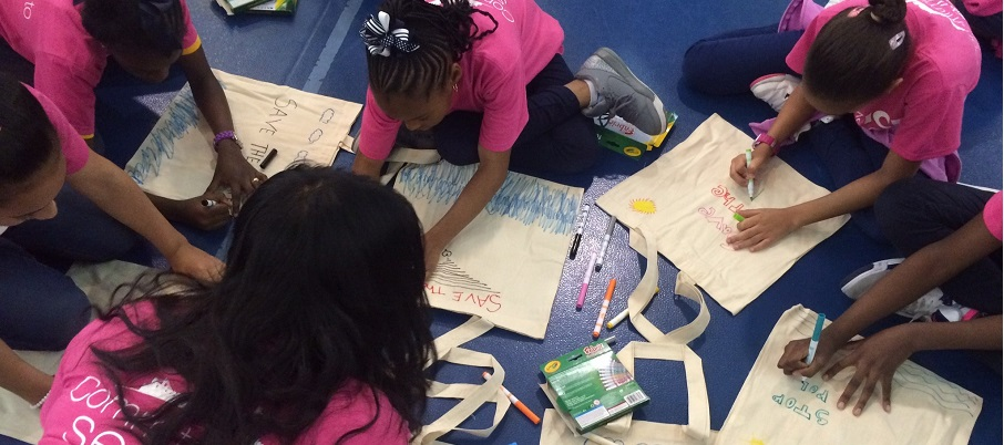 Students decorate reusable bags to promote sustainability