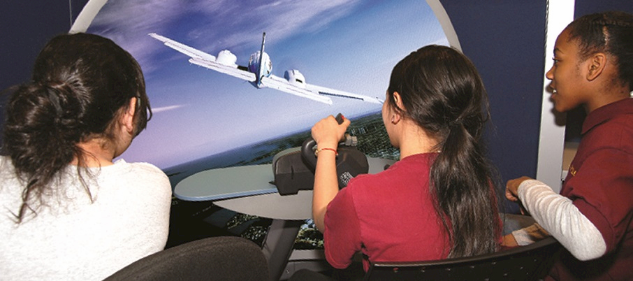 Students with a flight simulator