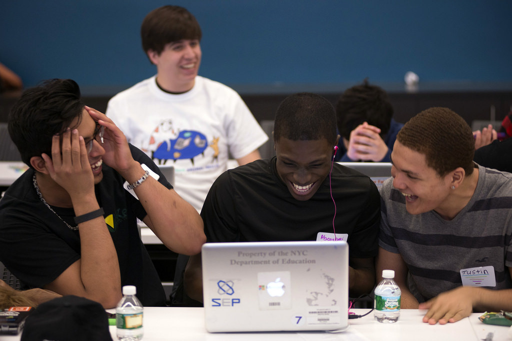 Students laughing at a hackathon