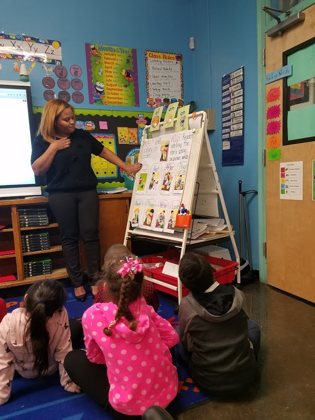 teacher explaining sequence words to young students