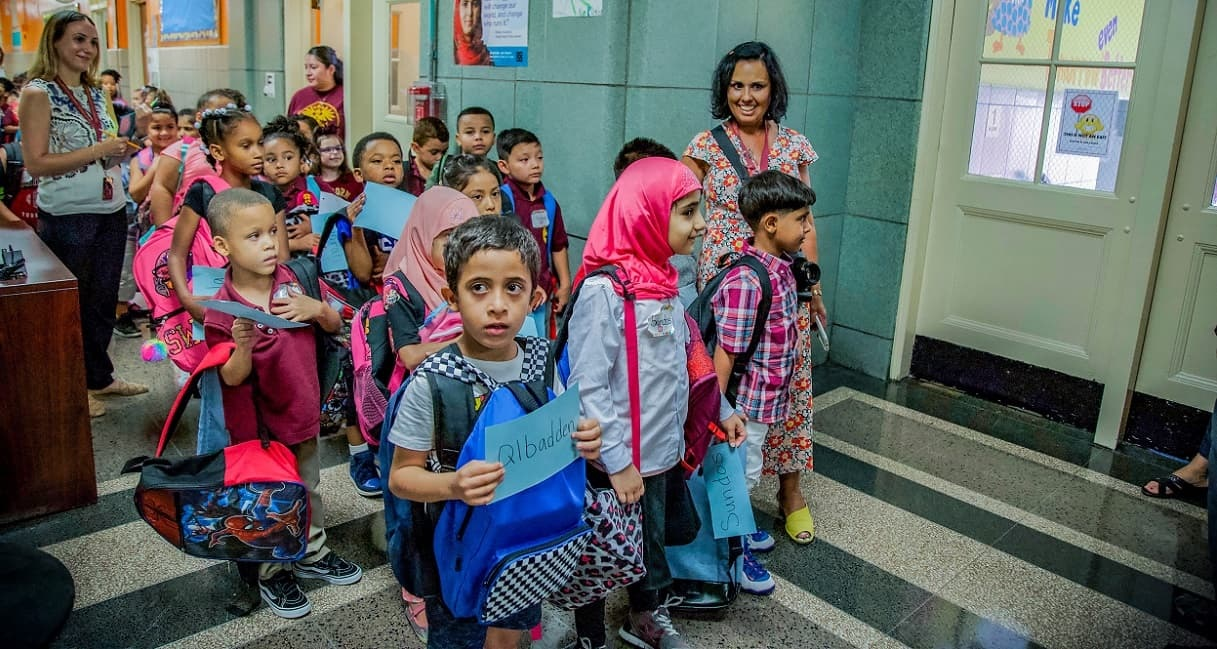 Children line up to go back to school