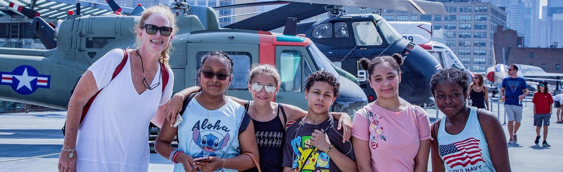 Students with a teacher on the Intrepid during a class trip