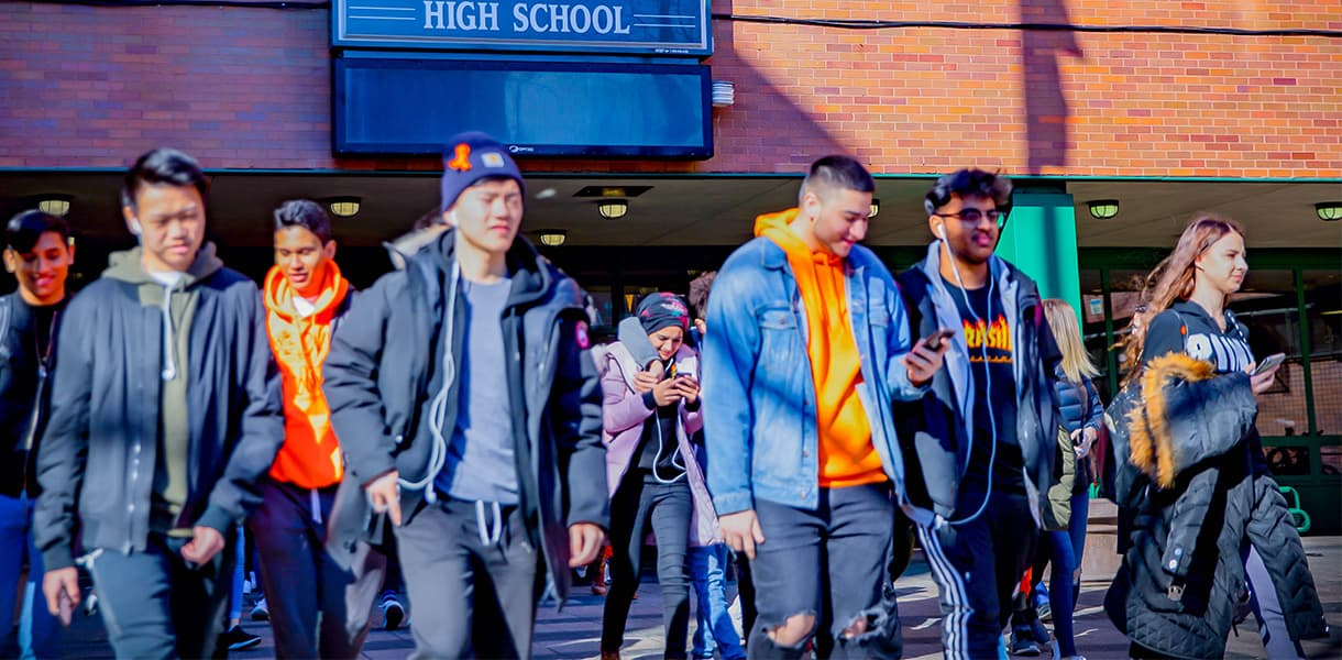 Students leaving high school, ready for a break from the routine.